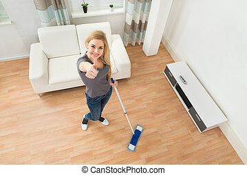 Woman Mopping Floor - High Angle View Of Young Woman Mopping...