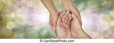 Compassion banner - Wide banner with a woman's hands holding...