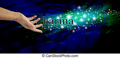 Creating Karma - Female hand outstretched with the word...