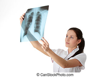 X-ray - Female doctor looking at an x-ray