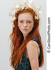 Beautiful ginger girl with flowers in hair. Clean skin -...