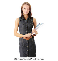 Female university student smiling and carrying some...