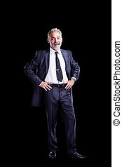 Confident businessman isolated on a dark background