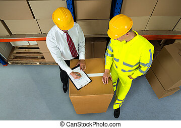 Warehouse Manager Checking Inventory In Warehouse