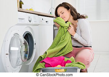 Woman With Clothes Near The Washer - Young Woman Crouching...