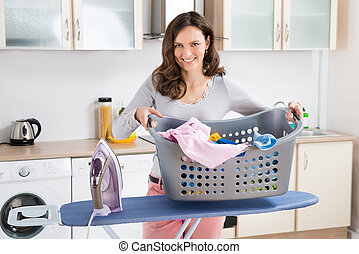 Woman With Electric Iron And Clothes - Happy Woman With...