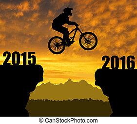 Concept of New Year 2016 - Silhouette cyclist jumping into...