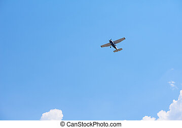 small airplane - small retro airplane, clear blue sky in...