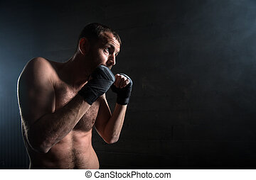 young boxer in light weight with bare-chested in fighting...
