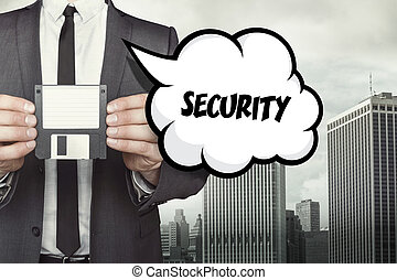 Security text on speech bubble with businessman holding...