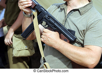 soldier with a submachine gun in his hand in training camp...