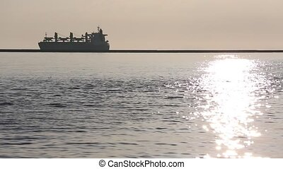 port at the background - Cargo ship on the sea the port at...