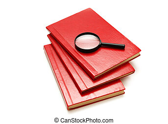 Three books and magnifying glass isolated on white