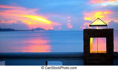 Sunset on the seashore of Samui Island, Thailand. Video water ripples in sea and Stone lantern shines