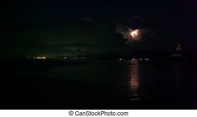 Lightning in the sea during the night time. Flies Ufo. Time...
