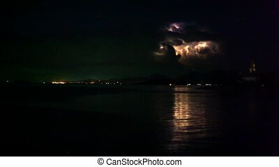 Lightning in the sea during night time Time lapse -...