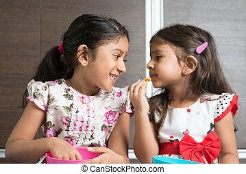 Sibling eating foods - Eating traditional snack murukku....