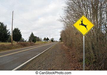Deer Elk Crossing Road Sign in a contry rura street road