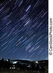 Star Trails Long Exposure At Night Located in a country...