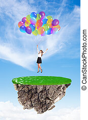 Girl with baloons - Happy girl with baloons landing to...