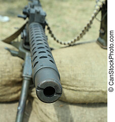 machine gun with bullets over the sandbags in trench warfare...