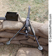 machine gun with bullets over the sandbags in the trench war...