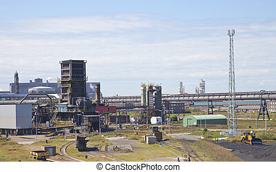 View at steel factory with blue sky
