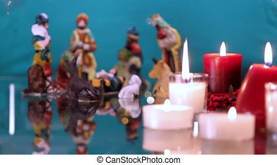 Christmas nativity scene with candles on green background...