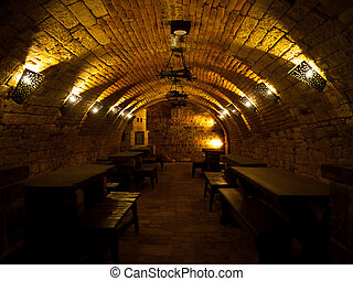 Dark wine cellar with tables