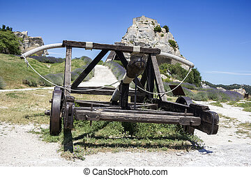 Medieval weapon Catapult - Old wooden medieval catapult at...
