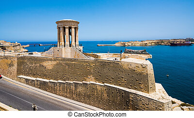 Siege Bell Memorial in Valletta on the sea background in...