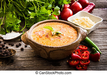 Sope queso with vegetables on wooden background - Sope queso...