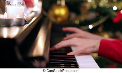 Girl hands playing piano