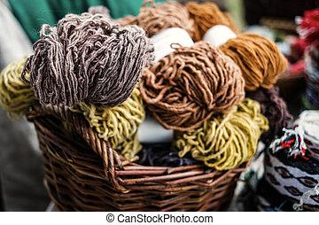 woolen yarn in baskets