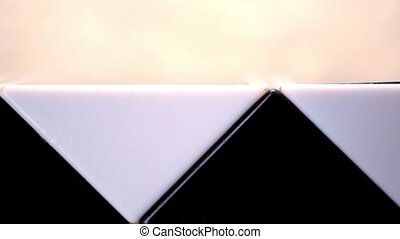 Close up of elements constructed on basis Of the triangle, black and white