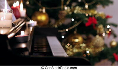 Piano keyboard on Christmas - Piano keyboard with burning...