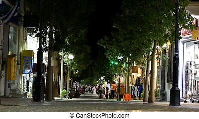 Greece. City center at night. - People walking, teenagers...