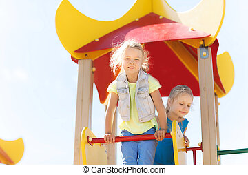 happy kids on children playground - summer, childhood,...