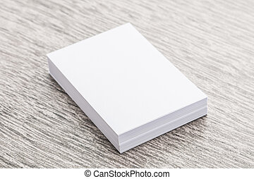 White paper mock up on wood background
