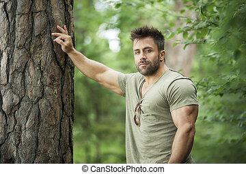 bearded man - An image of a bearded man in the woods