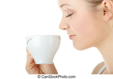 Blond woman drinking coffee - Young attractive blond woman...