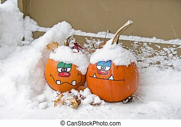 Halloween pumpkins in snow - Pair of fun fun faces painted...