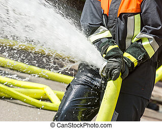 Fireman with a firehose - Water splashing out of a firehose...