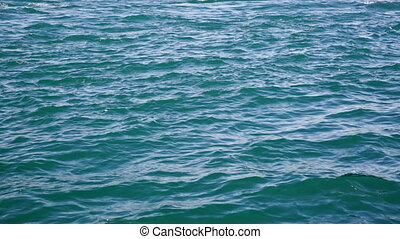Small waves on blue sea water