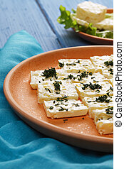 Plate of cheese closeup - Plate of cheese with chapped...