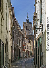 street in Maastricht - street with historical building in...