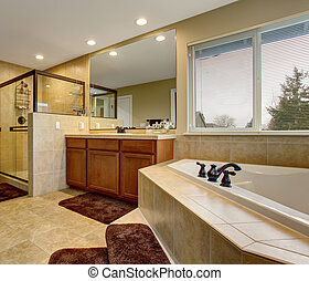 Gorgeous bathroom with glass shower, and large bath.