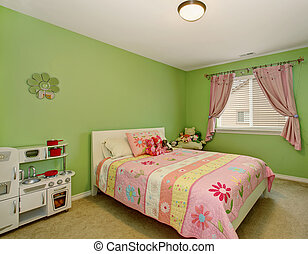 Perfect girls bedroom with green walls.