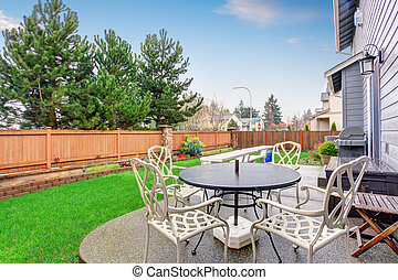 Beautiful furnished back yard with patio and fence. -...
