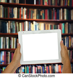 empty tablet with library shelfs in background - Hands...